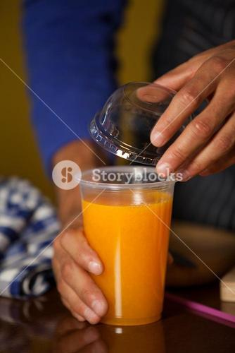 Male staff putting straw in a glass