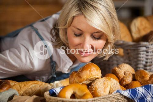 Female staff smelling various sweet food
