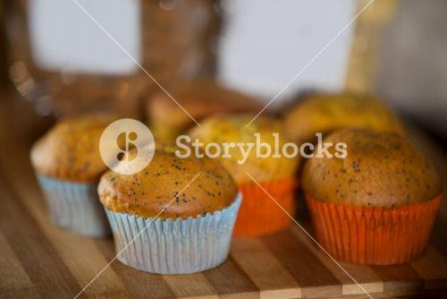 Close-up of cupcakes on wooden board