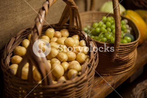 Basket full of grapes and potato at counter