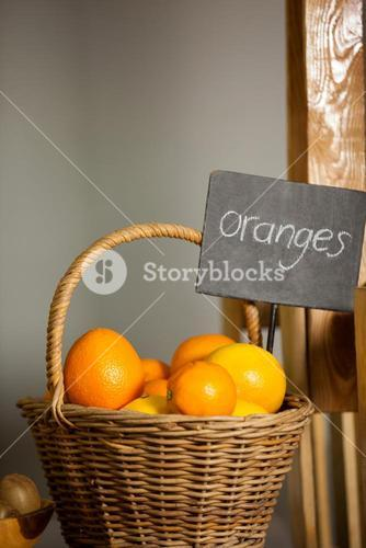 Juicy orange in wicker basket at organic section