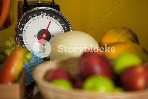 Close-up of weighing scale and fruits in organic section
