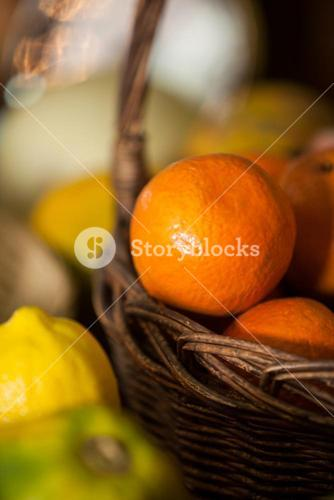 Close-up of fresh oranges in wicker basket at organic section