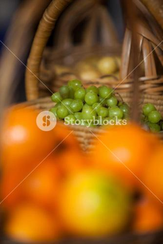 Juicy grapes in wicker basket at organic section