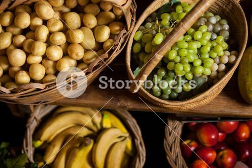 Various fruits and vegetables in wicker basket at organic section