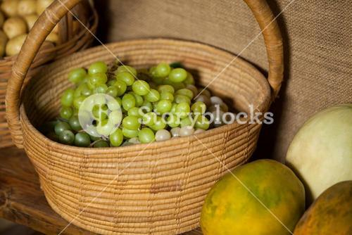 Close-up of fresh grapes in wicker basket
