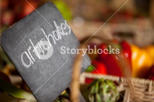 Close-up of placard with artichokes word in organic section
