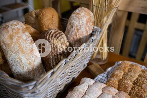 Close-up of fresh bread in a wicker basket on counter