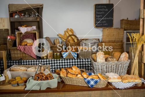 Various bread and cookies on counter