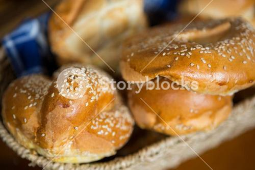 Close-up of croissants in wicker basket at counter