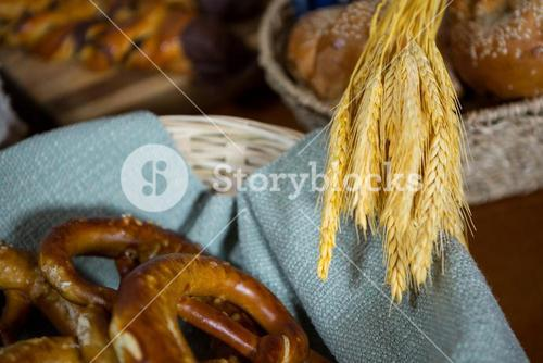 Ears of wheat and pretzel breads at counter