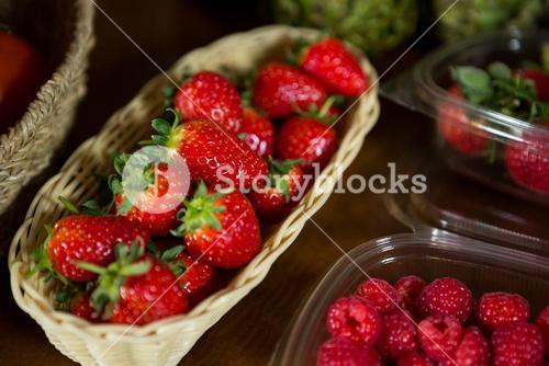 Close-up of small wicker basket full of strawberry at organic section