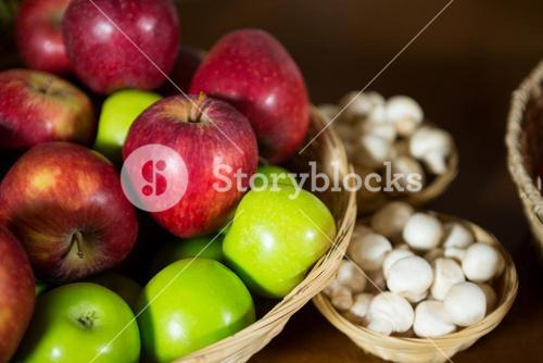 Close-up of small wicker basket full of apples at organic section