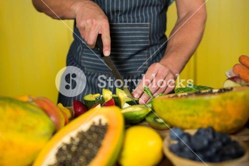 Staff chopping avocado at counter