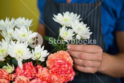 Florist holding flowers in florist shop