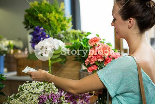 Woman making payment at counter