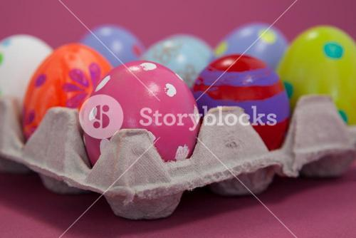 Colorful Easter eggs in egg carton