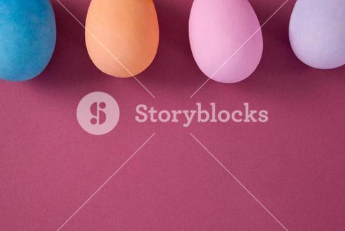 Easter eggs arranged on pink background