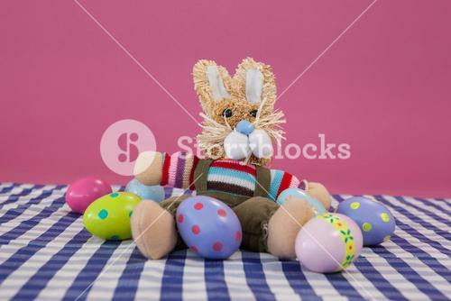 Various Easter eggs with soft toy