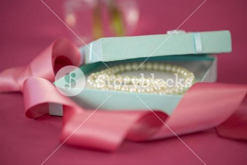 Pearl necklace in opened gift box