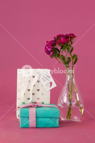 Gift box, paper bag and flowers vase