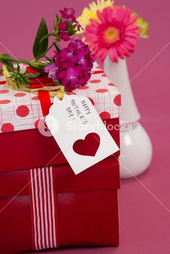 Happy mothers day card and flowers on gift boxes