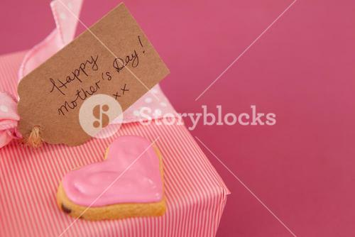 Close-up of gingerbread cookie with gift box