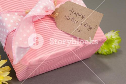 Gift box with happy mothers day card and flowers