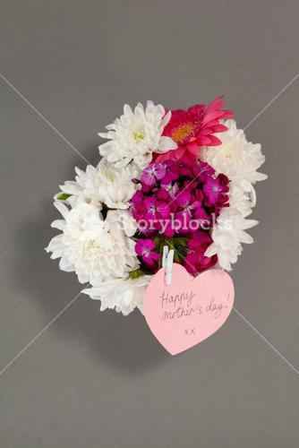 Bunch of fresh flowers with happy mothers day card