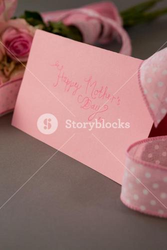 Close-up of happy mothers day card