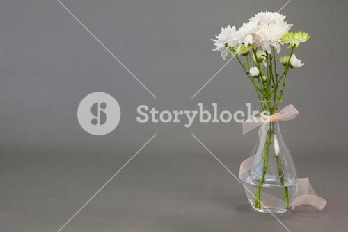 Flower vase tied with ribbon