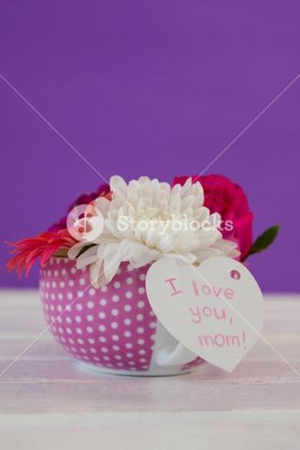 Bunch of fresh flowers with I love you mom card