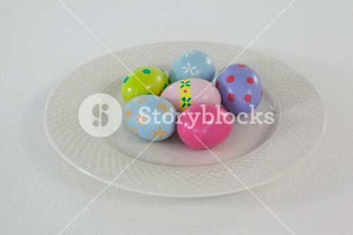 Painted Easter eggs arranged in plate