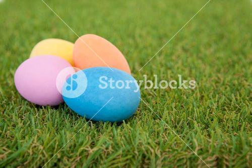 Painted Easter eggs arranged on grass