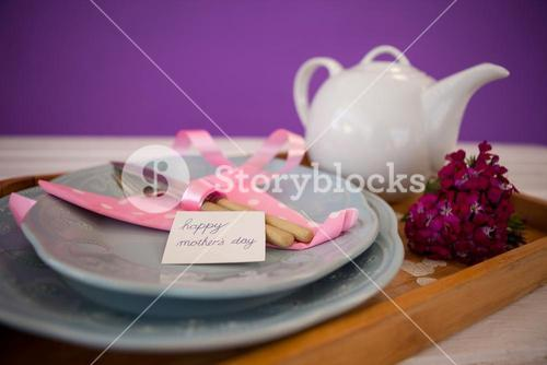 Happy mothers day card with teapot on wooden tray