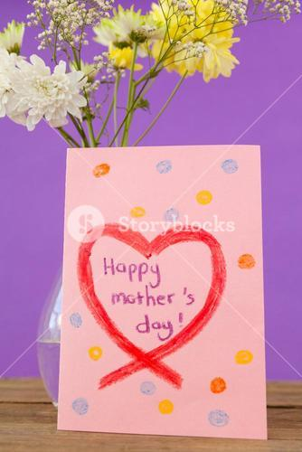 Happy mothers day card with flower vase on table