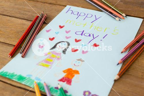 Happy mothers day greeting card on wooden background
