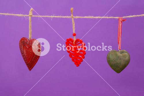 Hearts with different designs hanging on rope