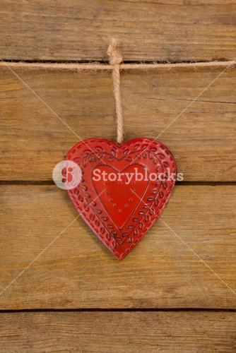 Red textured heart hanging on rope