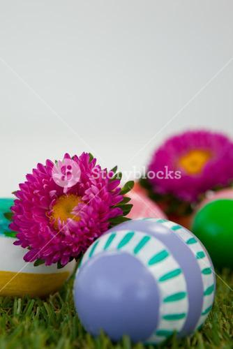 Painted easter eggs with flower on grass