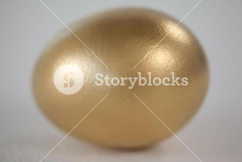 Golden eastern egg on white background