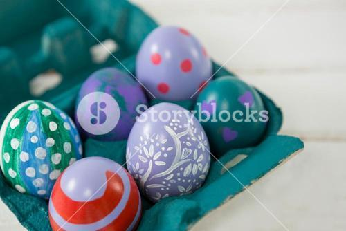 Multicolored Easter eggs in the carton