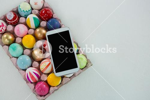 Mobile kept on painted Easter eggs in egg carton