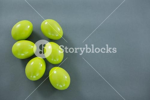 Green Easter eggs on grey background