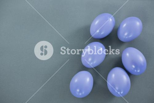 Violet Easter eggs on grey background