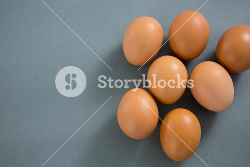 Brown eggs on grey background