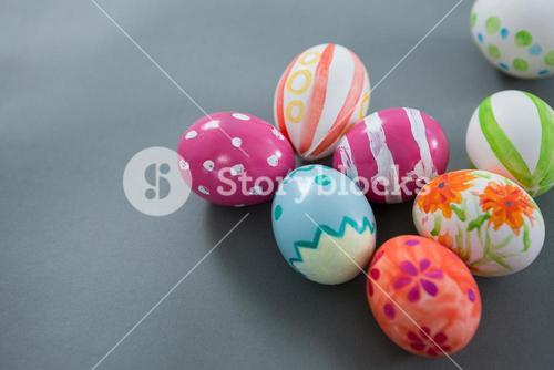 Multicolored Easter eggs on grey background