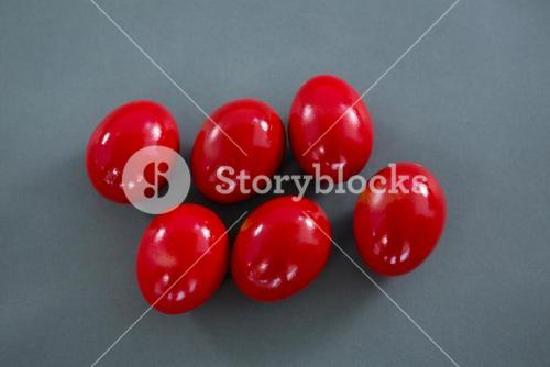 Red Easter eggs on grey background