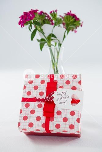 Gift box with happy mothers day tag and flower vase