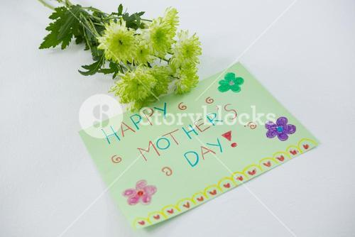 Close-up of happy mothers day card with flowers